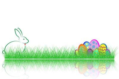 Frohe Ostern. Kaninchen und bunte Eier im grünen Gras mit Reflex