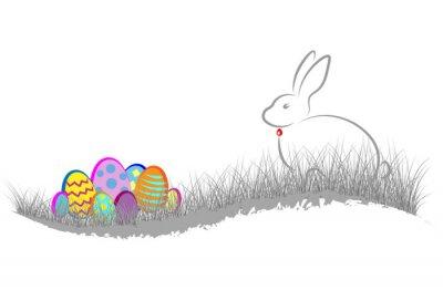Frohe Ostern. Kaninchen und Eier bunt im Gras