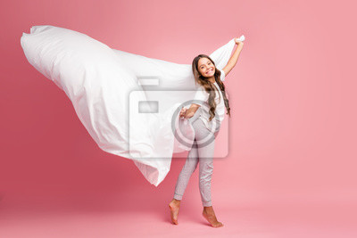 Sticker Full length body size view of nice attractive cheerful funky wavy-haired pre-teen girl wind blowing soft duvet new cotton house domestic collection isolated on pink pastel color background