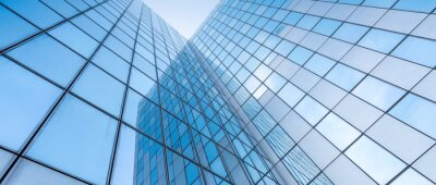 Sticker glass facades of modern office buildings and reflection of blue sky