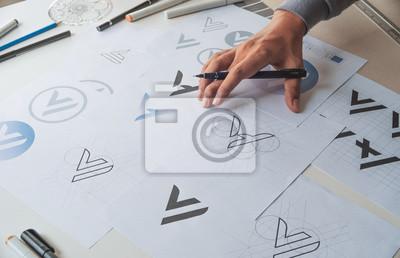 Sticker Graphic designer development process drawing sketch design creative Ideas draft Logo product trademark label brand artwork. Graphic designer studio Concept.