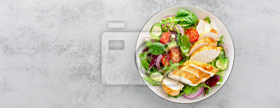 Sticker Grilled chicken breast, fillet and fresh vegetable salad of lettuce, arugula, spinach, cucumber and tomato. Healthy lunch menu. Diet food. Top view. Banner