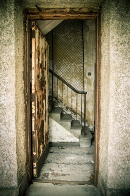 Sticker Grungy abandoned home with door and stairs