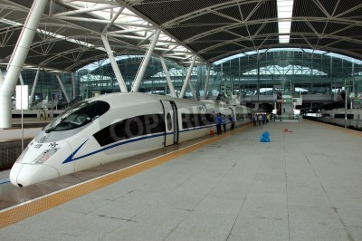 Sticker GUANGZHOU, CHINA - SEPTEMBER 29: China invests in fast and modern railway, trains with speed over 340 km/h. Train to Wuhan on September 29, 2010 waits in newly build Guangzhou South station.