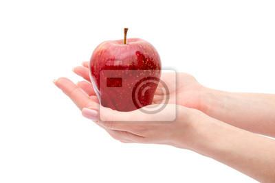 Hand der Frau mit einem Apfel auf weißem Hintergrund