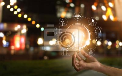 Sticker Hand hält Glühbirne vor global, zeigen Sie den Verbrauch der Welt mit Ikonen Energiequellen für erneuerbare, Ökologie-Konzept. Elemente dieses Bildes von der NASA eingerichtet.