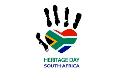 Sticker Hand with the flag of south africa for heritage day, vector art illustration.