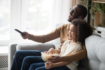 Sticker Happy black dad and daughter cuddle watching TV