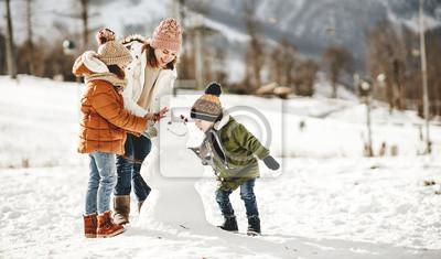 Sticker happy family mother and children having fun on winter walk