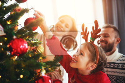 Sticker happy family mother, father and child daughter decorate Christmas tree  .