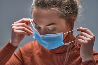 Sticker Healthy woman putting on medical protective mask to health protection and prevention during flu virus outbreak, epidemic and infectious diseases