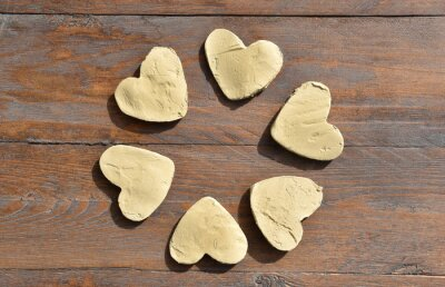 Hearts of Clay on Wooden background. Flower of hearts. Valentines Day. Art Design,