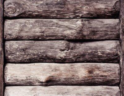 Holzwand aus Holzstämmen als Hintergrundtextur