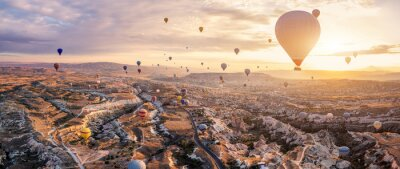 Sticker Hot air balloons flying above Göreme, Cappadocia (Kapadokya) Anatolia, Turkey at sunrise. Panoramic view of villages and fairy chimneys. Popular touristic destination for summer vacation holidays