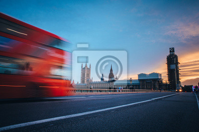 Iconic red double decker on Westminster Bridge front of House of parliament and Big Ben in London