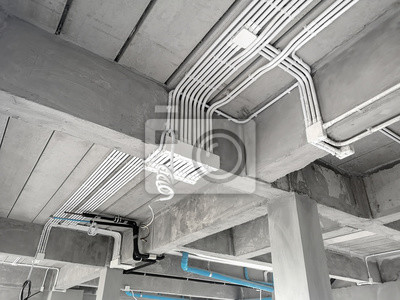Sticker Installation of electrical wiring on the ceiling.Electrical cable system installation.