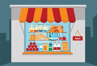 Kleines Geschäft mit offenen Regale mit Waren.