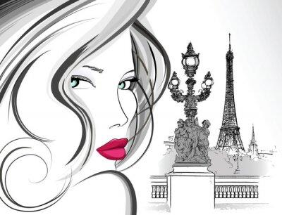 Kobieta na moście Aleksandra III w Paryżu