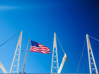 Sticker Low Angle View Of American Flag At Utah Olympic Oval Against Clear Blue Sky