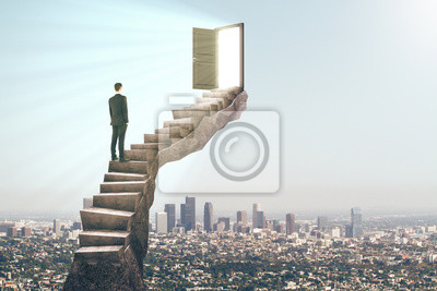 Man on stairs with door