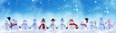 Sticker Merry Christmas and happy New Year greeting card with copy-space.Many snowmen standing in winter Christmas landscape.Winter background
