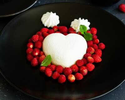 modern dessert from creamy mousse with wild strawberry.