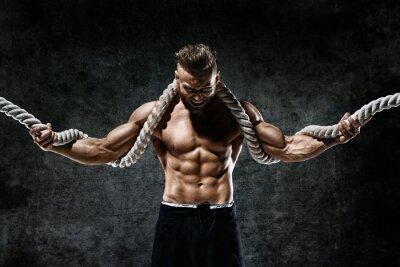 Sticker Muskulöser Mann mit Seil. Foto des Mannes mit perfektem Körper nach dem Training. Modestil
