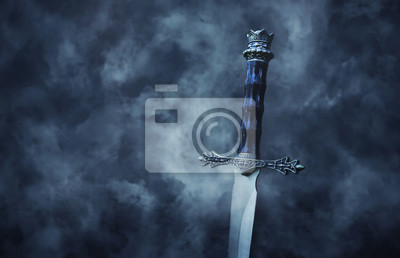 Sticker mysterious and magical photo of silver sword over gothic black background with smoke. Medieval period concept