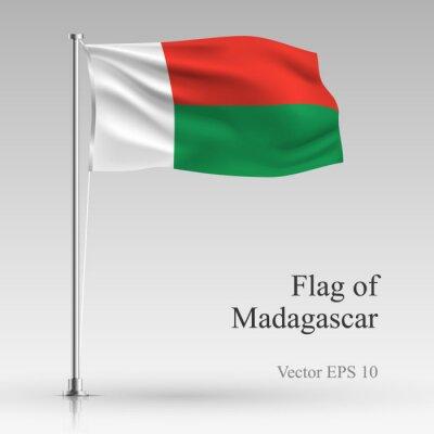 National flag of Madagascar isolated on gray background. Realistic Madagascar flag waving in the Wind. Wavy flag of Madagascar Vector illustration.