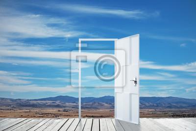 Open door on landscape background