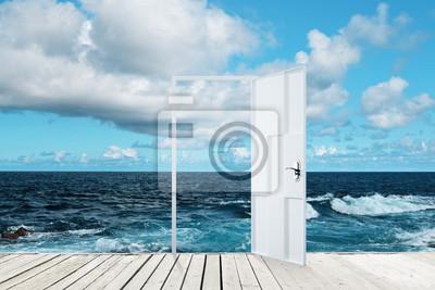 Open door on sea background