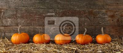 Sticker Orange halloween pumpkins on stack of hay or straw