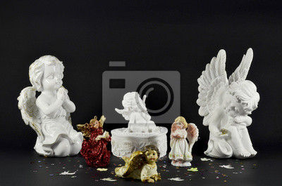 Ornamental angels for Christmas gifts on black