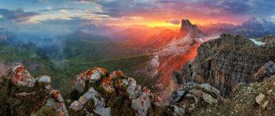 Sticker Panorama dramatic sunset in dolomites alp mountain from peak Nuv