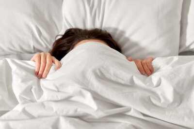 Sticker people, bedtime and rest concept - woman lying in bed under white blanket or duvet