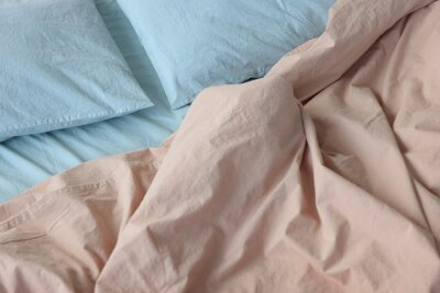 Sticker photo of washed cotton bedding: beige duvet cover and blue pillowcases