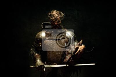 Sticker Portrait of a knight in armor, his sword in his hand, holding a dragon head in the other hand