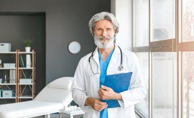 Sticker Portrait of senior male doctor in clinic