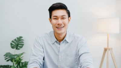 Sticker Portrait of successful handsome executive businessman smart casual wear looking at camera and smiling, happy in modern office workplace. Young Asia guy talk to colleague in video call meeting at home.