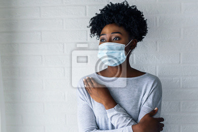 Sticker Portrait of young African-American woman wearing disposable medical face mask