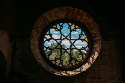 Sticker Round stained glass window in old abandoned castle
