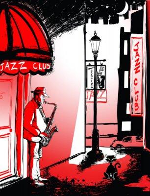 Saxophonspieler in einer Straße in der Nacht
