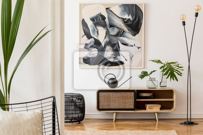 Sticker Scandinavian and design home interior of living room with wooden commode, design black lamp, rattan basket, plants and elegant accessories. Stylish home decor. Template. Mock up poster paintings.