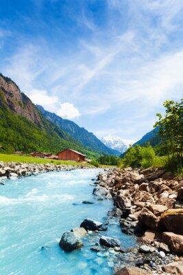 Sticker Schöne Schweizer Landschaft mit Fluss-Stream