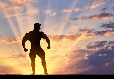 Sticker Silhouette der Bodybuilder wirft bei Sonnenuntergang