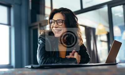Sticker Smiling asian businesswoman at office