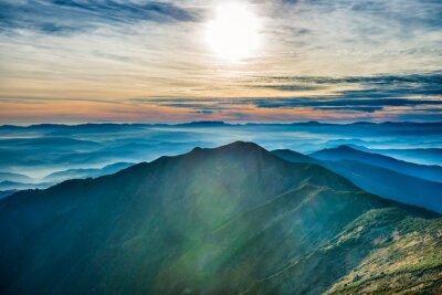 Sticker Sonnenuntergang in den Bergen