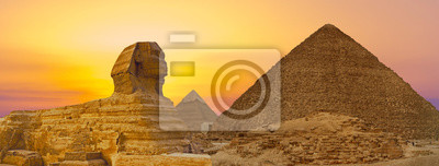 Sticker Sphinx against the backdrop of the great Egyptian pyramids. Africa, Giza Plateau.