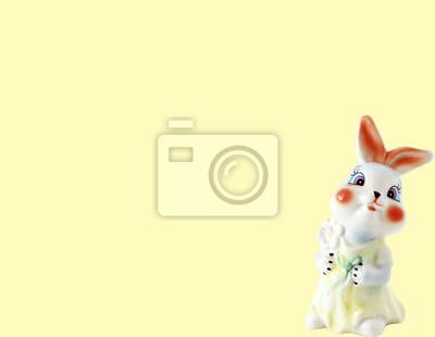 Stock-Foto-Hintergrund-für-Kinder-und-Text-mit-Keramik-Bunny-Figur-gelbe Banner