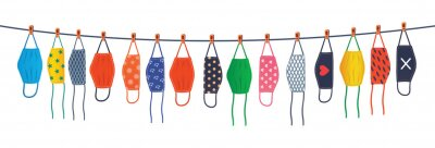 Sticker The colorful reusable masks are hanging on a line. Drying reusable masks.